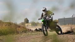 Motocross dirtbike rider turning in Stock Footage