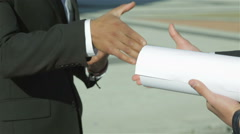 Good deal. Two confident engineer shaking hands in formalwear - stock footage