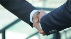 Good deal. Two confident businessman handshake Stock Footage