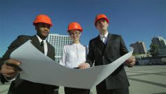 Three confident business architect in protective helmet standing on the site - stock footage