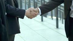 Welcoming new invite partners handshake Stock Footage