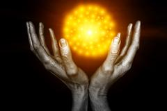 silvery male hands with a yellow energy ball - stock illustration