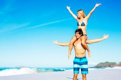 atractive couple having fun on the beach - stock photo