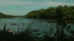 Paddle board class on the James River - time lapse Stock Footage