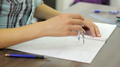 Girl drawing with compass Stock Footage