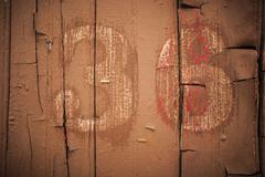 """36"" or ""3"" or ""6"" Text On Side Of Old Textured Wooden Boxcar Wall - stock photo"