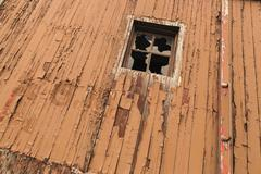 Broken Window On An Old Wooden Decaying Boxcar - Broken Glass - stock photo