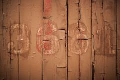 """3661"" or ""3"" or ""6"" or ""1"" On Side Of Old Wooden Boxcar - stock photo"