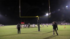 Extra point good kick night game wide shot Stock Footage