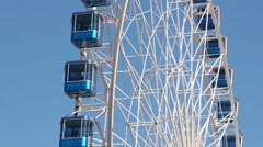 Ferris wheel in front of blue sky Stock Footage