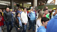 Fans go to Arena Sao Paulo for the game Uruguay x England, the World Cup Stock Footage