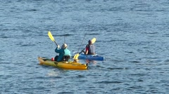 Two Kayakers Paddling Out To Go Fishing Stock Footage