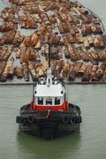 Tugboat and Log Boom Stock Photos