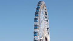 Ferris wheel in front of blue sky Stock Footage