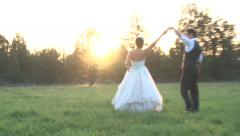 Happy Bride and Groom in Sunset Field Stock Footage