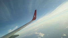 4K Flying on Turkish Airlines Wing Logo Stock Footage