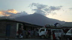 Trucks Pack in Front of Mt. Meru Stock Footage