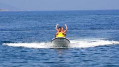 Happy couple on jet ski. teen couple cruises the ocean on a jet ski. Stock Footage