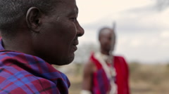 Masai Men In Circle, One With Spear in Tanzania - stock footage