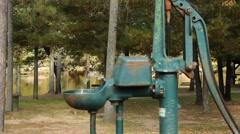Vintage hand powered water pump Stock Footage