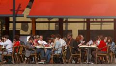 People on European terrace having lunch and enjoying the spring sunshine Stock Footage