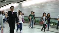 People walking inside the Hong Kong Station. Stock Footage