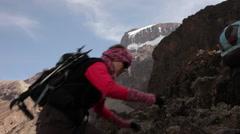 Stock Video Footage of Solo Climber Kilimanjaro Backdrop