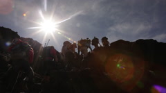 Stock Video Footage of Low Angle Lens Flare on Climbers on Kilimanjaro