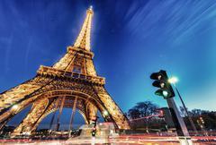 paris - december 1, 2012: wonderful night illumination of tour eiffel. eiffel - stock photo