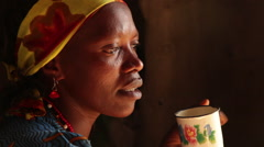 Tanzanian Woman Sips Chai Close Up Stock Footage