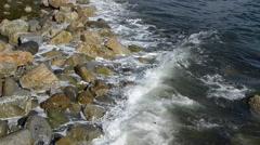 Waves Washing Onto Rocky Shoreline Stock Footage