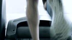 Running on treadmill at the gym Stock Footage