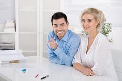 happy young academics making training and adjustment for a new job - stock photo