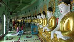 Buddhist Pilgrims at U Min Thonze Pagoda in Sagaing, Mandalay, Myanmar (Burma) Stock Footage