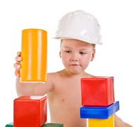 Child a builder builds a house.boy with blocks Stock Photos