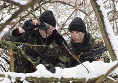warriors with a weapon.ambush.military action. - stock photo