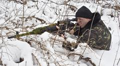 sniper rifle to the position. - stock photo