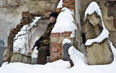 commando.sniper with an weapon on position.warrior is in ruins of city. - stock photo