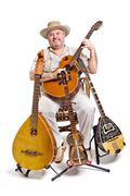 Musician with ethnic musical instruments on a white background. Stock Photos