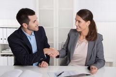 Business talk with shaking hands: counselor and customer or hello to a new co Stock Photos
