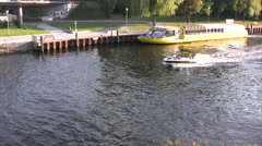 Small Powerboat going along river at Potsdam Stock Footage