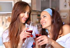 Happy women drinks wine Stock Photos