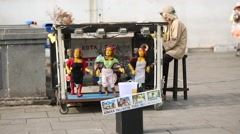 Dancing puppets with the puppeteers Stock Footage