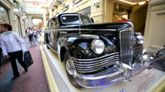 Stock Video Footage of The Soviet car ZIS-115 inside Gum Department store.
