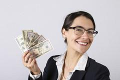 Businesswoman holding earnings Stock Photos
