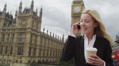 Young business woman on a mobile phone - stock footage