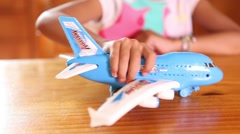 Role playing, airplane toy Stock Footage