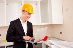 Engineer calculates estimates for repair Stock Photos