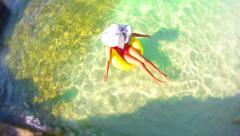 4k, summer concept, female enjoy relaxing on inflamable rubber ring, aerial h Stock Footage