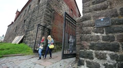 Tourists visit medieval tower of St. Olaf. Stock Footage